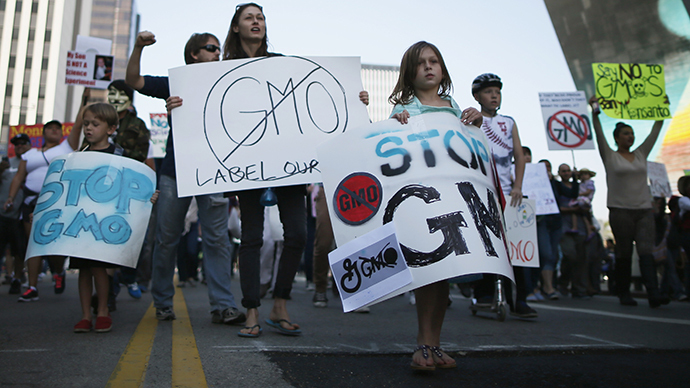 "People hold signs during one of many worldwide ""March Against Monsanto"" protests against Genetically Modified Organisms (GMOs) and agro-chemicals, in Los Angeles, California October 12, 2013. (Reuters / Lucy Nicholson)"