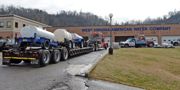 Known as 'buffalos', water tanks from Northern PA were arrive at a steady pace at West Virginia American Water on January 10, 2014 in Charleston, West Virginia.(AFP Photo / Tom Hindman)