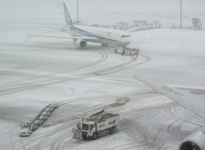 aircraft stuck in snow on airport japan