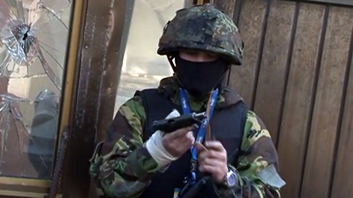 Armed rioter on the streets of Kiev on February 18.(Screenshot from YouTube video uploaded by Ukraine's Interior Ministry)
