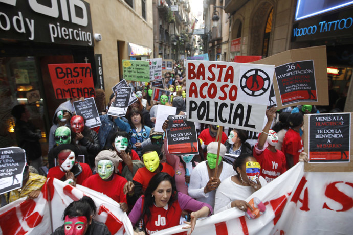 "Members of the platform of ""Indignant Prostitutes"" and their supporters staged a demonstration in central Barcelona to protest against the city's plans to modify a law that seeks to prohibit street prostitution in the Catalan capital, April 26, 2012. (Reuters/Gustau Nacarino)"