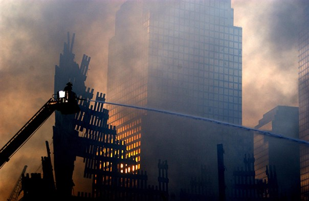 Firemen continue to fight the fires that sprout up from within the rubble of the World Trade Center September 19, 2001. (Reuters / PA2 Tom)