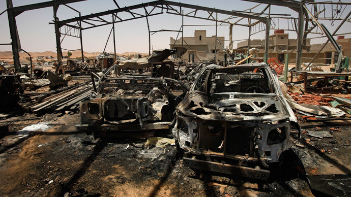 A building used by Gaddafi troops to service vehicles is seen in rubble following a NATO airstrike in the town of Bir al-Ghanam in western Libya, August 8, 2011.(Reuters / Bob Strong)