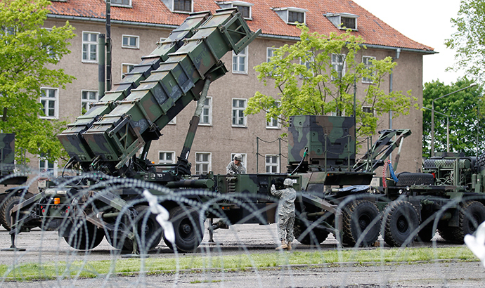 U.S. soldiers stand next to a Patriot surface-to-air missile battery at an army base in Morag, Poland (Reuters)