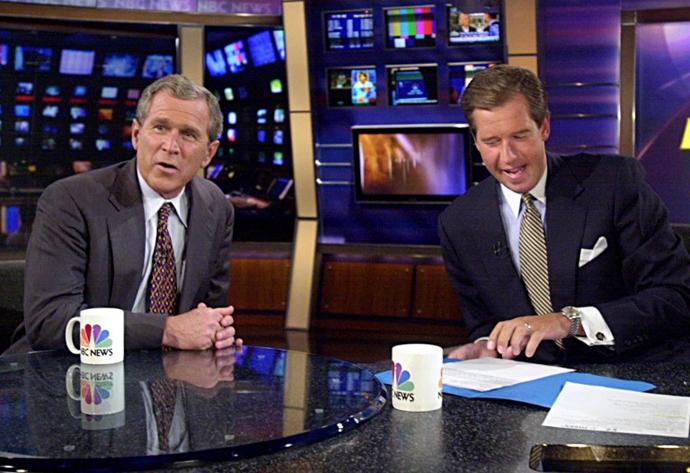George W. Bush talks with MSNBC anchor Brian Williams. (AFP Photo / Tannen Maury)