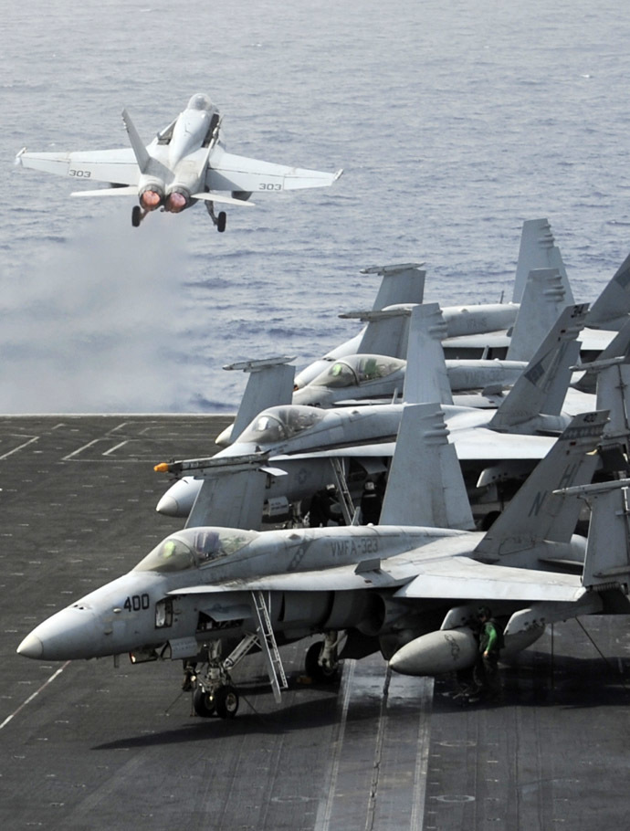 A picture downloaded on September 4, 2013 from the US Navy website and taken on September 3, 2013 shows an F/A-18C Hornet assigned to the Blue Diamonds of Strike Fighter Squadron (VFA) 146 launching off the flight deck of the aircraft carrier USS Nimitz in the Red Sea. (AFP Photo)