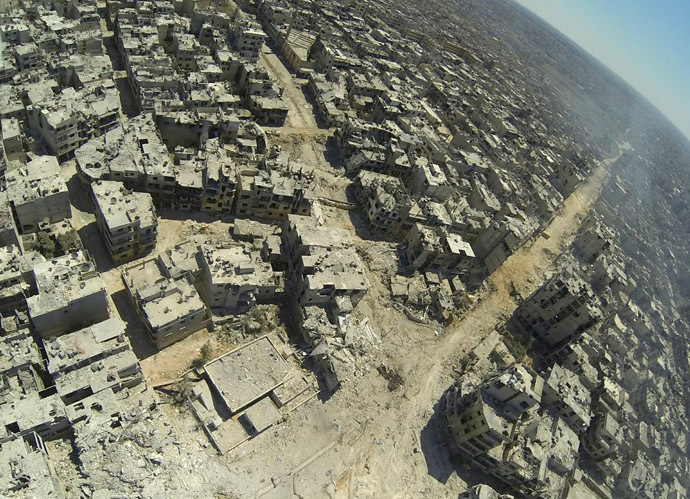 A handout image released by the Syrian opposition's Shaam News Network on July 29, 2013, shows an aerial view of destruction in the al-Khalidiyah neighbourhood of the central Syrian city of Homs. (AFP Photo/Shaam News Network)