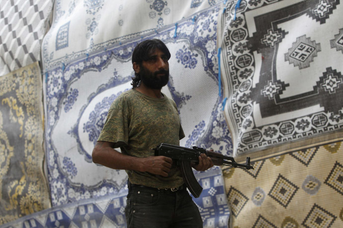 Free Syrian Army fighter (Reuters/Muzaffar Salman)