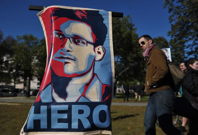 "A portrait of Edward Snowden declaring him a ""hero"" is seen during a protest against government surveillance on October 26, 2013 in Washington, DC.(AFP Photo / Mandel Ngan)"
