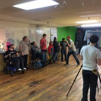 People with a variety of disabilities participate in a group activity