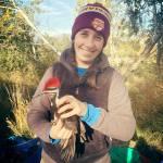 Lauren Smith holding a woodpecker