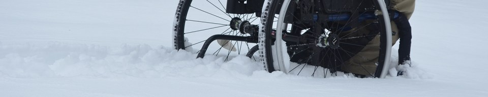 A wheelchair in the snow.