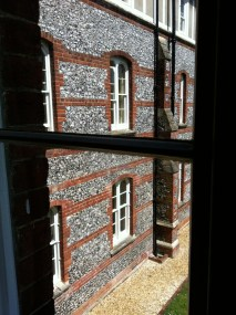 and from my window quite a good courtyard: knapped flint and brick (quite Wiltshire)