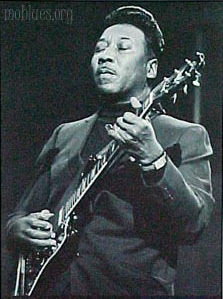 [Picture of Muddy Waters playing guitar]