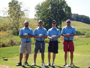 Mike (left), Ryan (middle left), and Sean (middle right) on the first tee box at the Operation HELP golf tournament