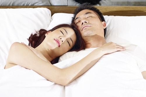 couple sleep on back