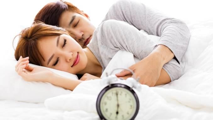 asian couple sleeping