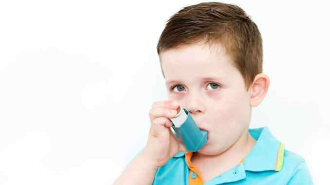 boy asthma inhaler
