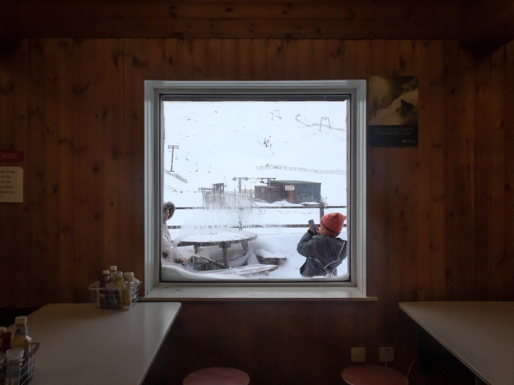 Looking through window at snowy scene
