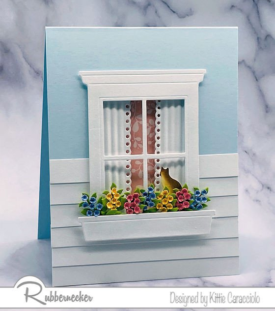an adorable realistic card made using a window die cut