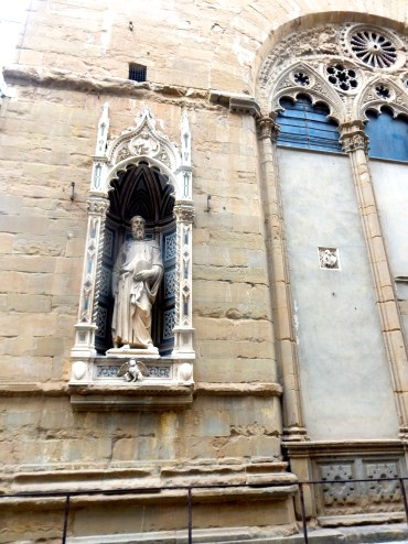 """Statue by Donatello, Orsanmichele. This one had a great past: apparently, Donatello had crafted the statue for certain guild, but when he revealed it to them, they hated it, complaining that the proportions were completely off--head too enormous, hands too big, etcetera. He was given a month to """"fix it."""" You know what Donatello did? No changes whatsover. At the end of the month, he revealed it once more to the guild, but this time, in its intended place--raised upon the façade of the Orsanmichele. They went nuts over it--it was perfect, he had fixed everything they had asked, yadiyadiya. So what changed? Donatello had mastered the budding Renaissance art of incorporating perspective into his sculpture. While on the same plane as the viewer the statue seems off, when raised to its proper placement on the Orsanmichele, the proportions appear perfect."""