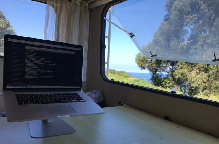 Working in the van right next to the sea