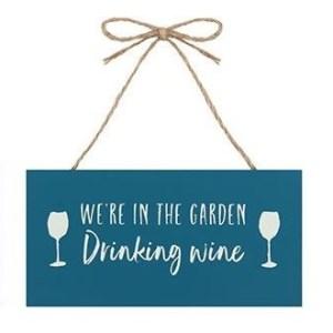 In The Garden Drinking Wine Plaque