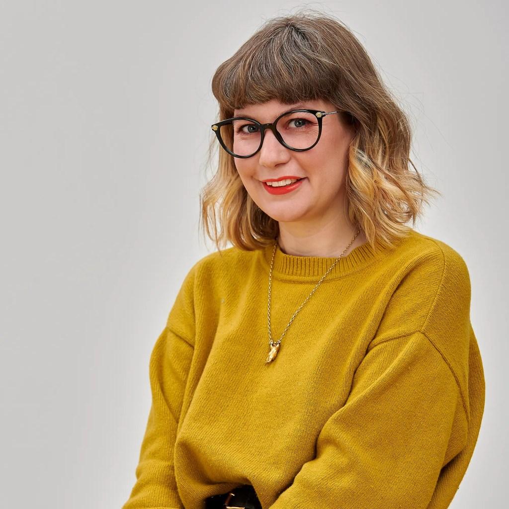 Ruby Rose wearing retro spectacle sustainable eyewear
