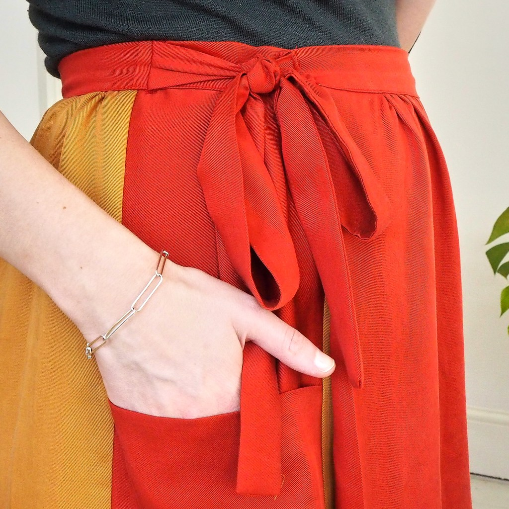 Close up of hand in the pocket of a wrap skirt