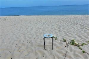 toilet seat on the beach