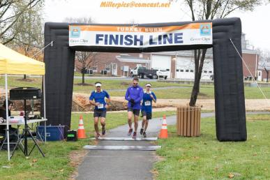 Ryan, Ted McClintic and I crossing the finishing line at the Turkey Burn.