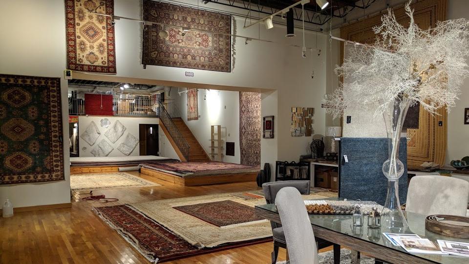 Old Ibraheems 636 S Broadway Denver, CO 80209 Showroom inside showing Oriental rugs