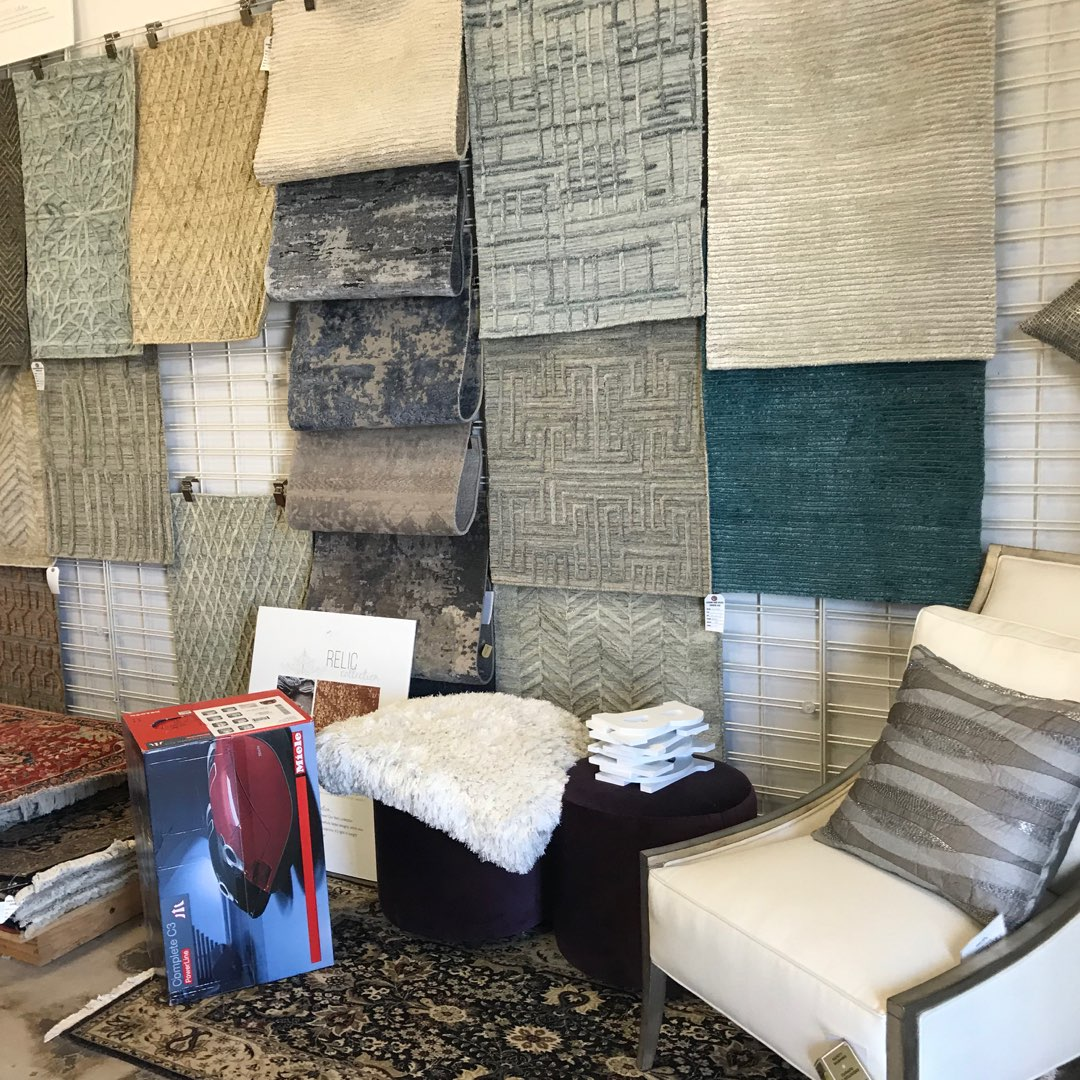 Ibraheems.com showroom, Oriental Rug and Carpet Clinic store front showing fine rugs on wall
