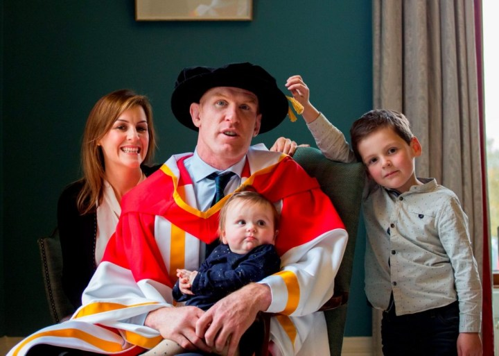 05/11/2015                 REPRO FREE The University of Limerick has awarded an Honorary Doctor of Science to former Ireland Rugby Captain Paul OÕConnell.  Dr Paul OÕConnell is the 100th recipient of an Honorary Doctorate from the University of Limerick since 1990. Dr Paul OÕConnell has a long association with the University of Limerick from his days training in the original PESS swimming pool as a secondary school student, to the years he spent studying computer engineering at UL.  He has been a director of the UL Foundation since 2011. In that role in 2012, he gave generously of his time to front the Paul OÕConnell Golf Outing, which raised in excess of Û50,000 to fund scholarships for students participating in ULÕs Access Programme. The scholarships enabled six students from socio-economically disadvantaged areas of Limerick to study degree programmes at the University.  Dr. Paul O'Connell is pictured with his wife Emily, children, Lola, 1 and Paddy, 5 as he prepared for the conferring ceremony. Picture: Alan Place/Fusionshooters.