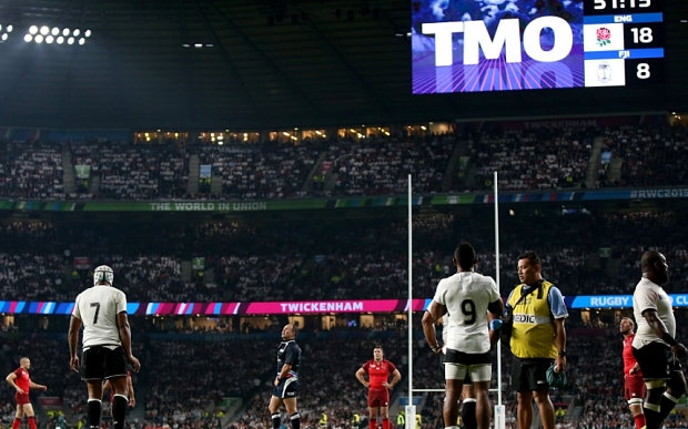 Mandatory Credit: Photo by James Crombie/INPHO/REX Shutterstock (5108173ab) Referee Jaco Peyper consults his TMO in the second half 2015 Rugby World Cup Group A, Twickenham, London, England vs Fiji - 18 Sep 2015