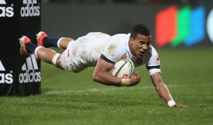 CHRISTCHURCH, NEW ZEALAND - JUNE 17: Anthony Watson of England dives to score a try during the match between the Crusaders and England at the AMI Stadium on June 17, 2014 in Christchurch, New Zealand. (Photo by David Rogers/Getty Images)