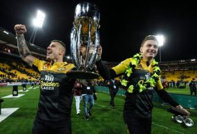 the-hurricanes-players-tj-perenara-and-beauden-barrett-holds-the-2016-super-rugby-trophy-at-westpac-stadium-wellington1-830x568
