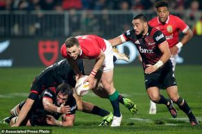 British and Irish Lions winger George North take the ball as Canterbury Crusaders Richie Mo'unga looks to tackle during their match in Christchurch, New Zealand, Saturday, June 10, 2017. (AP Photo/Mark Baker)