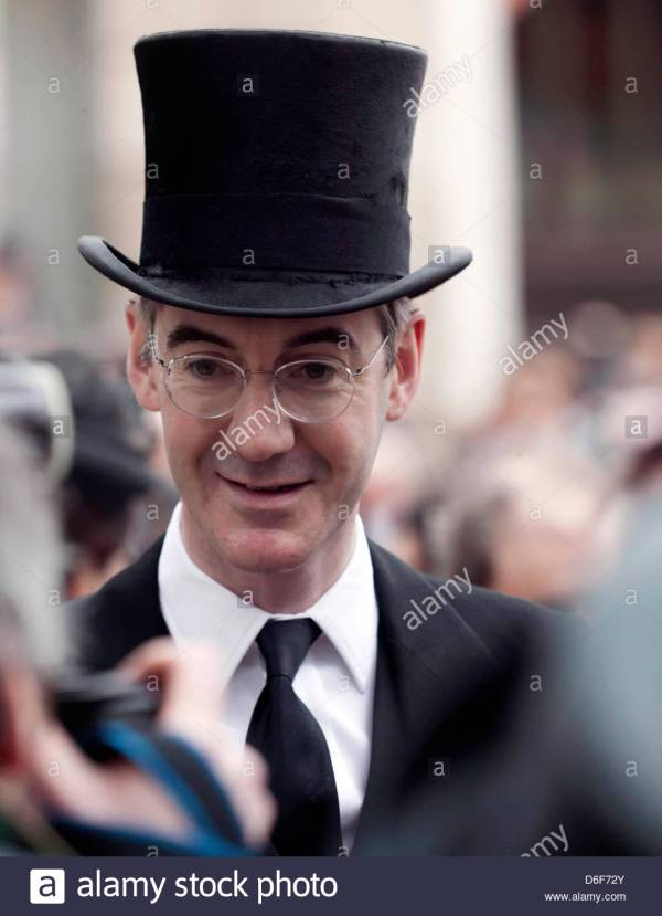 jacob-rees-mogg-wearing-a-top-hat-waits-to-enter-st-pauls ...