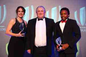 LONDON, ENGLAND - NOVEMBER 13: Alhambra Nievas (L) and Rasta Rasivhenge (R) are presented with the World Rugby Referees of the Year 2016 Award by Anthony Buchanan (C) during the World Rugby Awards 2016 at the Hilton London Metropole Hotel on November 13, 2016 in London, England. (Photo by Jordan Mansfield - World Rugby/World Rugby via Getty Images)