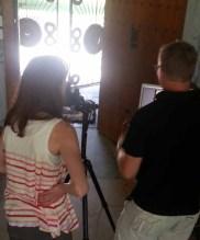 Kip Dawkins, photographer, and Alethea Morrison, art director, conferring.