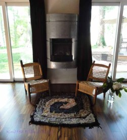 Brown and Gray Square Spiral by the fireplace.