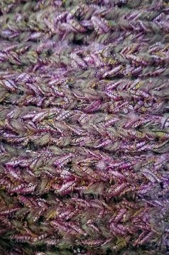 Ribbing in a blend of stash fingering and a pink ribbon.