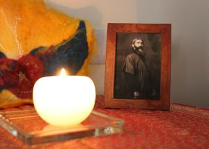 candle and photo of Hazrat Inayat Khan on altar
