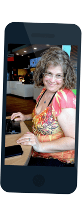 A photo of Debra Ruh, iPhone near by