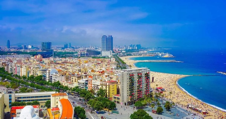 Take an affordable honeymoon to Barcelona Spain! Explore the city of Barcelona and see amazing Spanish architecture, learn Spanish culture and try delicious Spanish food. Then venture to the gorgeous Barcelona beaches for a romantic honeymoon in Spain!