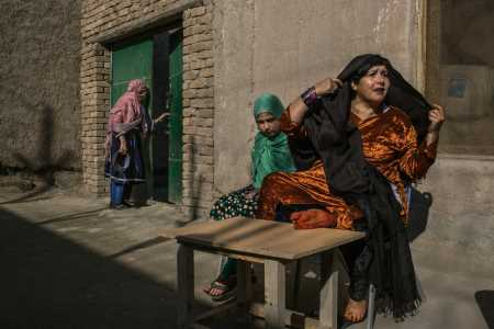 Shirin Gul and her daughter Meena, 11, in the women's wing of the Nangarhar provincial prison, in Jalalabad, Afghanistan, where Ms. Gul is serving a life sentence. Credit Mauricio Lima for The New York Times