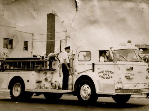 Bill Van Develde rides a Fair Haven fire truck circa early 1970s. Photo/Van Develde family