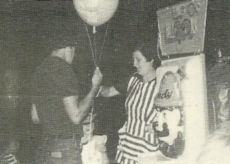 Sally Van Develde selling balloons at the Fair Haven Firemen's Fair Grab Bag Booth
