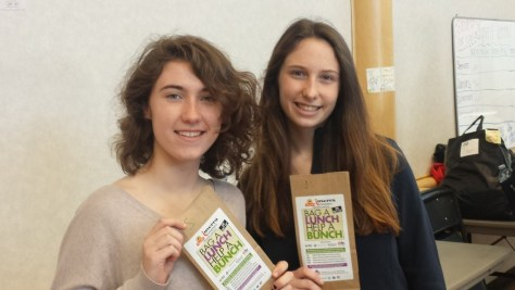 RFH team captains displaying a flyer created for the Bag a Lunch fundraising initiative are Victoria Hempstead and Willis Manelski. Photo/RFH